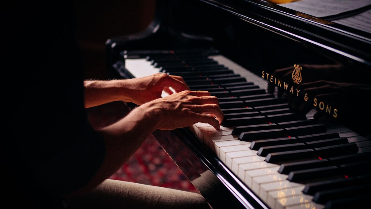 Man Playing a Steinway Piano